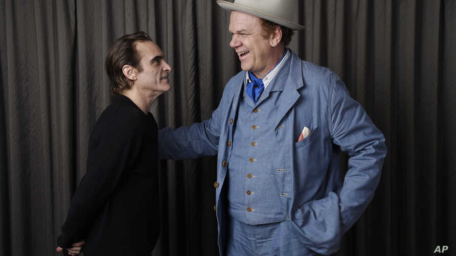 """In this Sept. 8, 2018 photo, Joaquin Phoenix, left, and John C. Reilly, cast members in the film """"The Sisters Brothers,"""" pose together for a portrait at the Adelaide Hotel during the Toronto International Film Festival in Toronto."""
