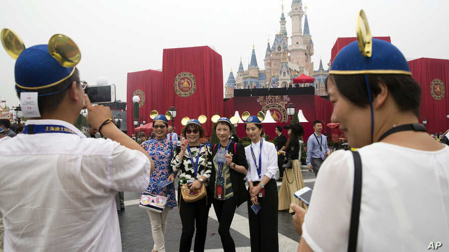Guests attend an opening ceremony for the Disney Resort in Shanghai, China, Thursday, June 16, 2016.