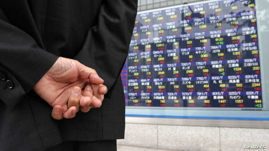 A man looks at a stock index board outside a brokerage, Tokyo, Japan, June 6, 2012 (file photo).