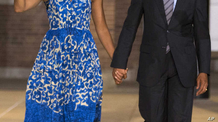 President Barack Obama and first lady Michelle Obama arrive for the Marine Barracks Evening Parade, Friday, June 27, 2014, in Washington