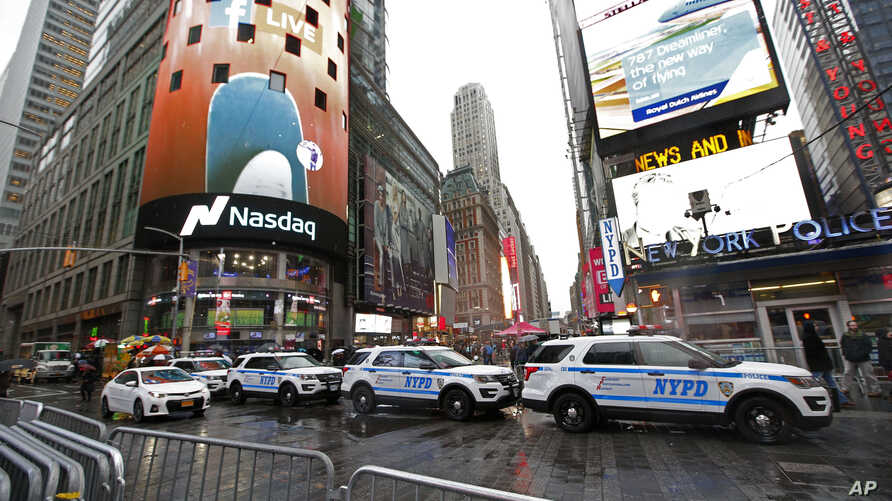 A row of New York City police cars is parked along a street in Times Square, Dec. 29, 2016, in New York.