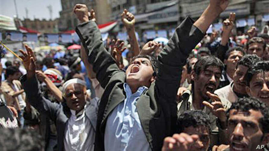 An anti-government protester reacts during a demonstration demanding the resignation of Yemeni President Ali Abdullah Saleh, in Sanaa, May 2 2011