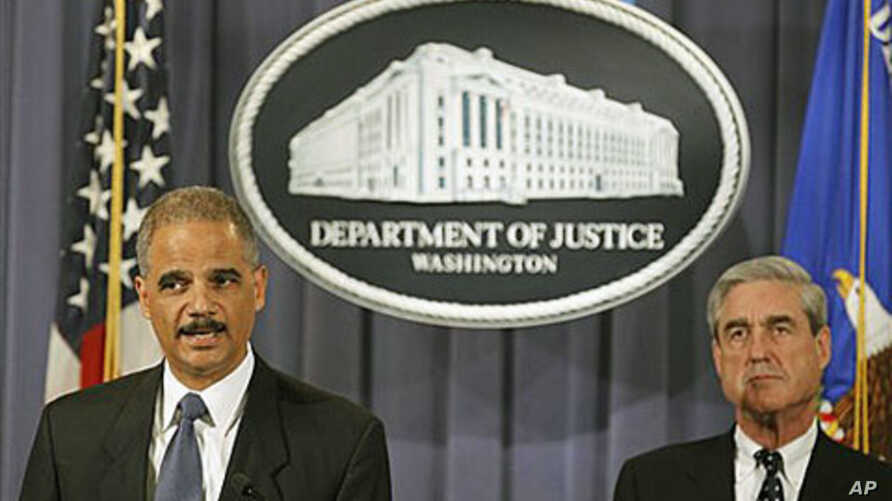Attorney General Eric Holder (L) accompanied by FBI Director Robert Mueller, announced that two men have been charged in New York for their alleged participation in a plot directed by the Iranian government to murder the Saudi Ambassador to the Unite