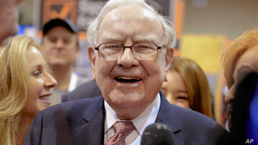 Berkshire Hathaway Chairman and CEO Warren Buffett laughs while touring the exhibit floor at the CenturyLink Center in Omaha, Neb., May 6, 2017, where company subsidiaries display their products.