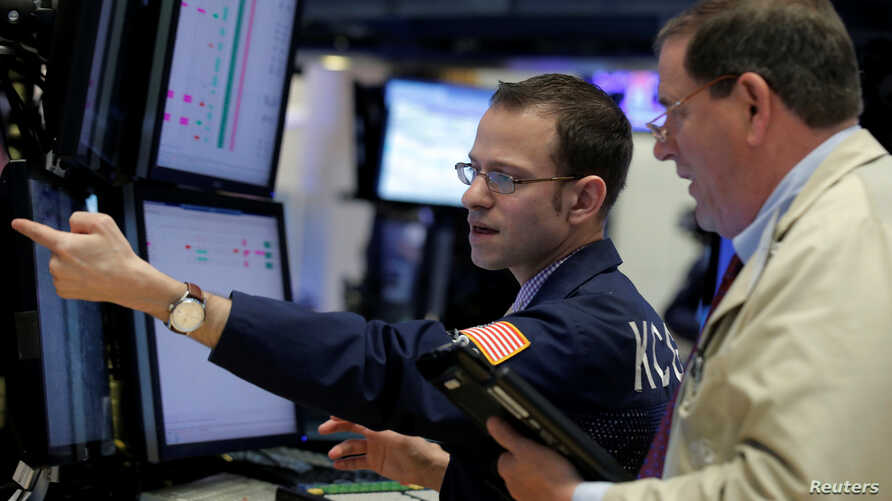 Traders work on the floor of the New York Stock Exchange (NYSE) in New York City, U.S., April 28, 2016.