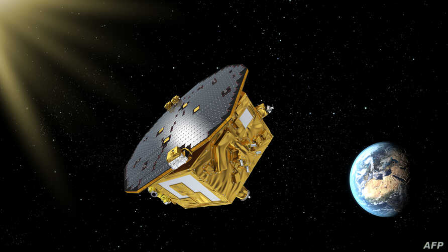 This handout image obtained from the European Space Agency on Nov. 29, 2015, shows an artist's impression of the LISA Pathfinder, designed to test technology for future gravitational-wave observatories in space.
