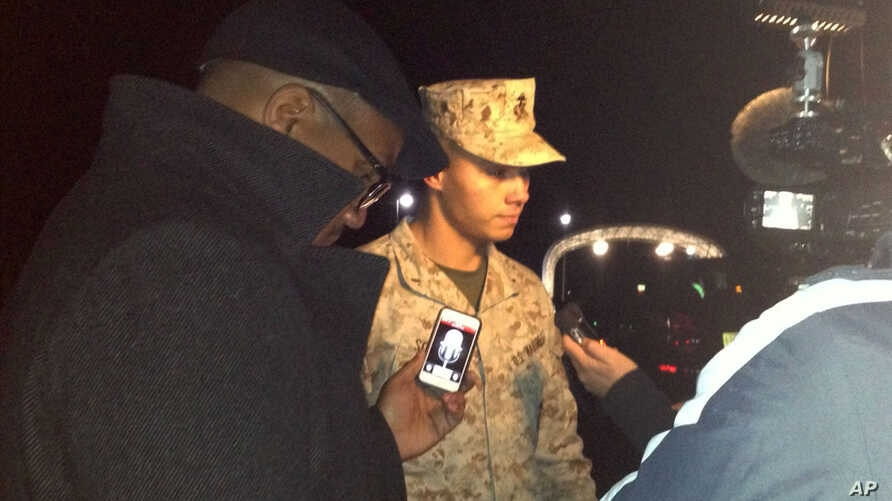 Marine Base Quantico spokesman Lt. Agustin Solivan briefs reporters following a shooting incident on the base, March 22, 2013.