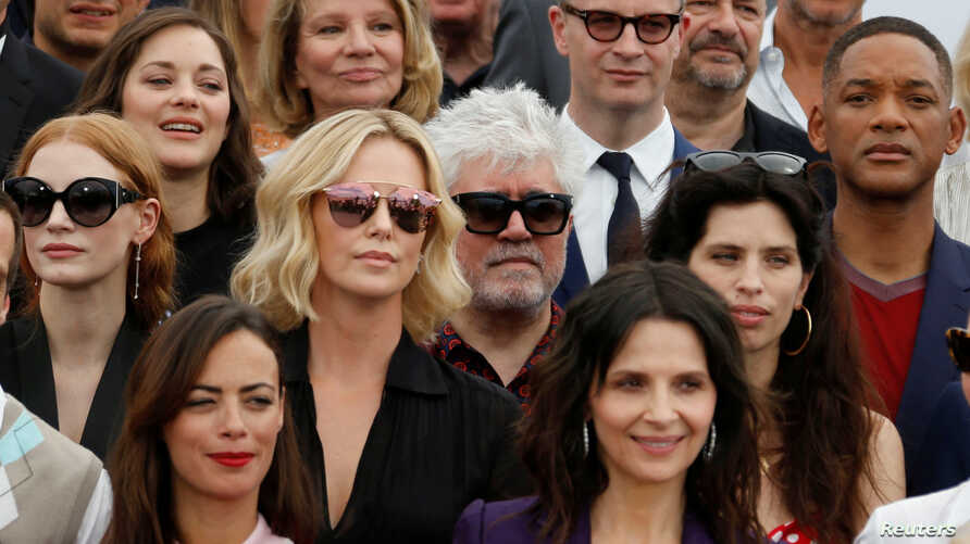 Jury members of the 70th Cannes festival, former Cannes festival award winners, actors and directors pose for a family picture.