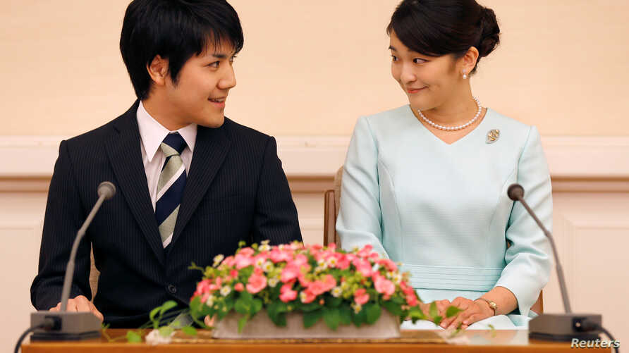 Princess Mako, the elder daughter of Prince Akishino and Princess Kiko, and her fiancee Kei Komuro, a university friend of Princess Mako, smile during a press conference to announce their engagement at Akasaka East Residence in Tokyo, Japan, Sept. 3,