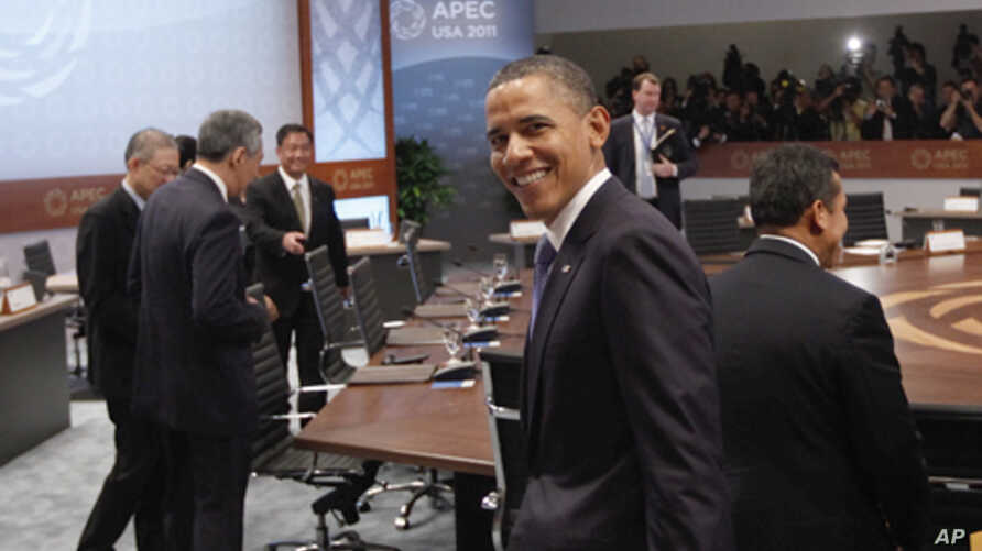 U.S. President Barack Obama looks over his shoulder was he arrives for the Asia-Pacific Economic Cooperation Summit leaders plenary session in Kapolei, Hawaii on Sunday, Nov. 13, 2011.