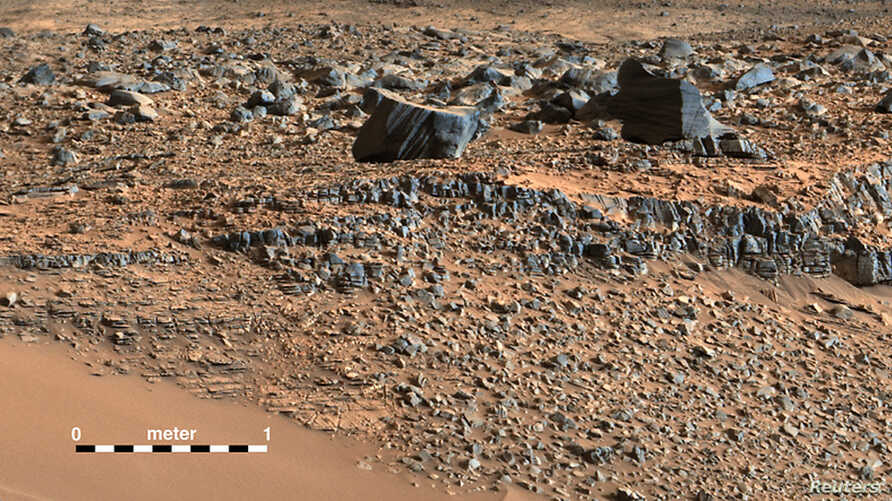 """A color mosaic taken by NASA's Mars Curiosity rover Mast Camera (mastcam) shows strata exposed along the margins of the valleys in the """"Pahrump Hills"""" region on Mars in this undated handout photo courtesy of NASA."""