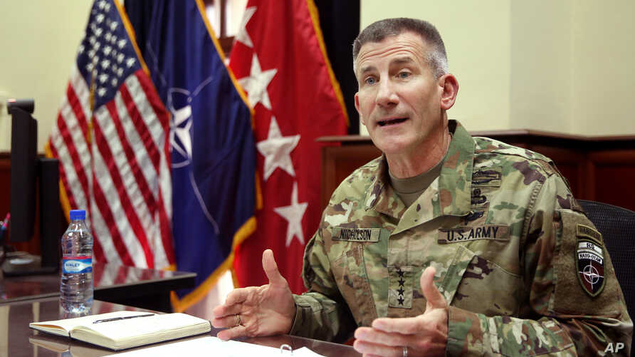 Head of NATO and U.S. forces in Afghanistan, U.S. Army Gen. John W. Nicholson, speaks during an interview with The Associated Press at his office, in Kabul, Afghanistan, July 27, 2016.