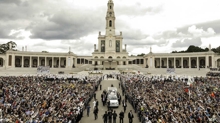 Pope Francis departs mass at which he canonized shepherd children Jacinta and Francisco Marto at the Sanctuary of Our Lady of Fatima, May 13, 2017, in Fatima, Portugal.