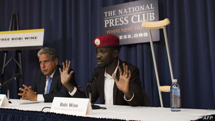 Ugandan politician Robert Kyagulanyi, better known as pop star Bobi Wine, gives a press conference with his lawyer Robert Amsterdam, left, on Sept. 6, 2018 in Washington, D.C. for the first time after being treated for beatings he allegedly received