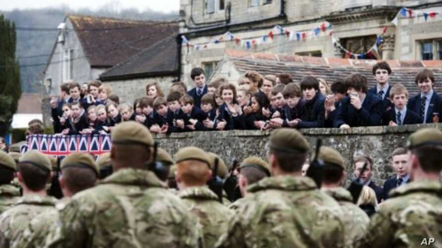 Yorkshire Regiment (3 YORKS) march past during a pre-deployment parade in Warminster, in Wiltshire, March 16, 2012.