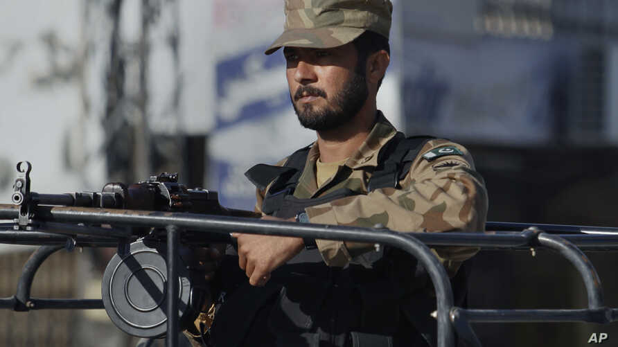A Pakistan army soldier mans at a vehicle during a curfew in Rawalpindi, Pakistan on Saturday, Nov. 16, 2013.