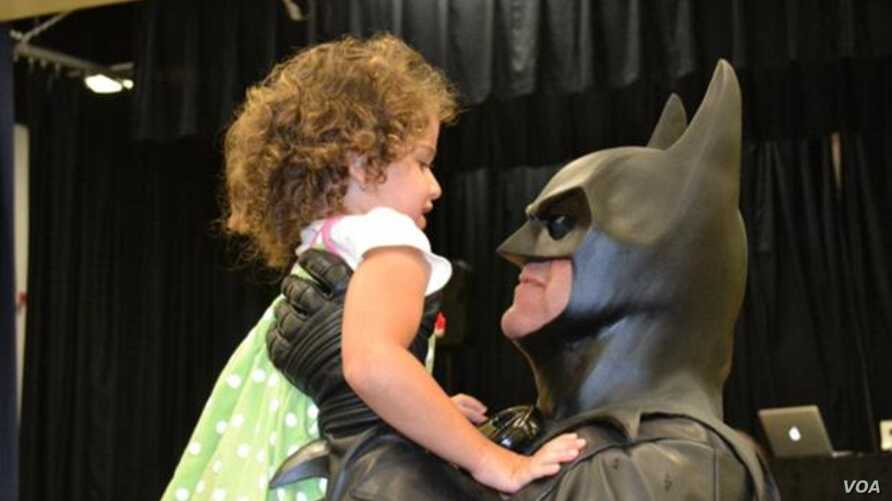 "FILE - ""Batman"" (Lenny Robinson) visiting sick children throughout the Maryland region."