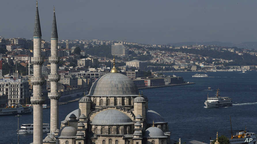 The New Mosque is backdropped by Istanbul's skyline and the Bosporus, July 9, 2015.