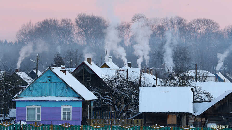 Smoke rises from the chimneys as the temperature dropped to around minus 24 degrees Celsius (minus 11.2 degrees Fahrenheit) in the village of Obadoutsy, Belarus, Jan. 9, 2017.