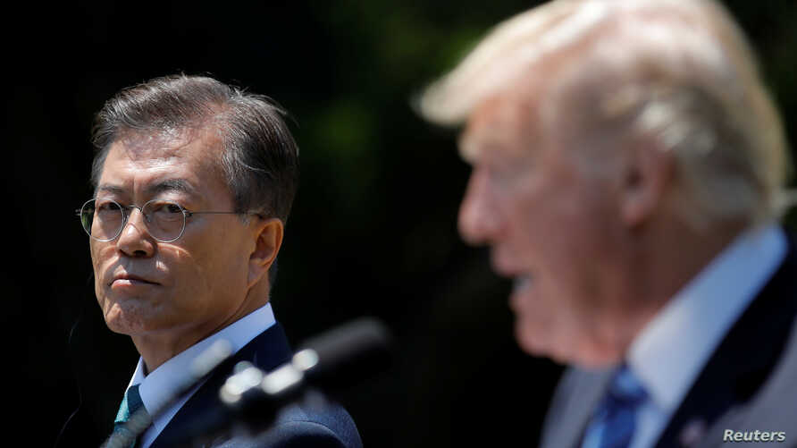 South Korean President Moon Jae-in and U.S. President Donald Trump, right, deliver a joint statement from the Rose Garden of the White House in Washington, June 30, 2017.