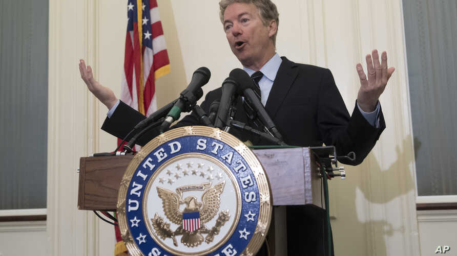 Sen. Rand Paul, R-Ky., tells reporters that he plans to oppose President Trump's nominations of CIA Director Mike Pompeo to be secretary of state and CIA Deputy Director Gina Haspel to lead the spy agency, during a news conference at the Capitol in W