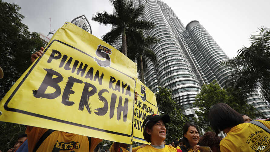 "Activists from the Coalition for Clean and Fair Elections (BERSIH) show a placard reading ""Clean Election BERSIH"" during a rally in Kuala Lumpur, Malaysia, Nov. 19, 2016."