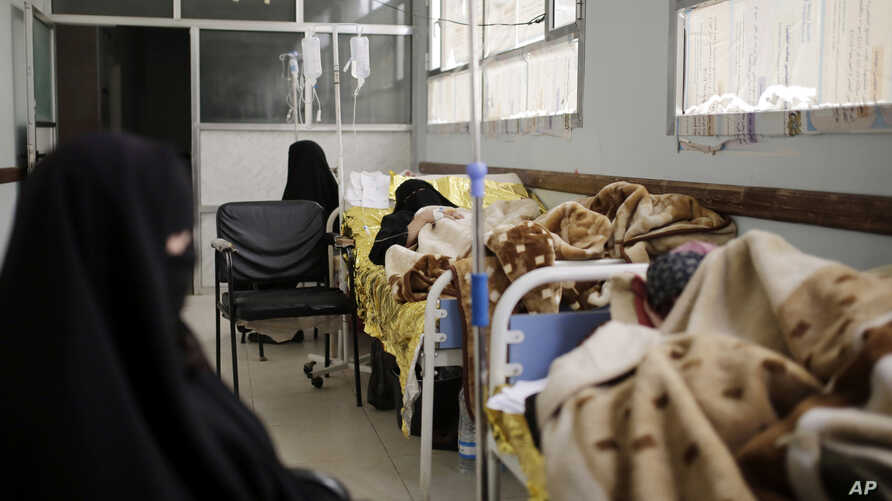 Women are treated for suspected cholera infection at a hospital in Sana'a, Yemen, Mar. 28, 2019.