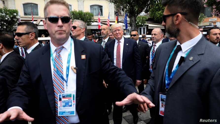 U.S. President Donald Trump is surrounded by Secret Service for an event with fellow G7 leaders during their summit in Taormina, Sicily, Italy, May 26, 2017.