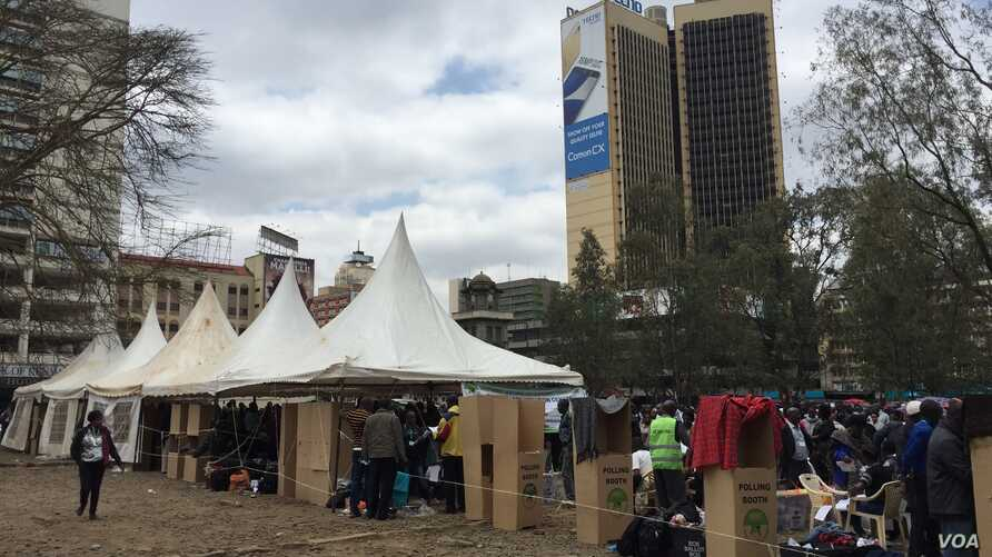 Cardboard voting booths are seen at a parking lot that has been temporarily converted into polling center, in downtown Nairobi, Kenya, Aug. 8, 2017. (J. Craig/VOA)