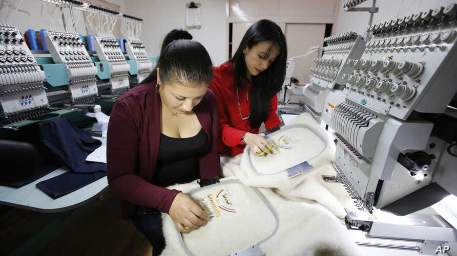 Women work on ruanas, which are traditional, pancho-style Colombian garments, in Nobsa, Colombia, Aug., 25, 2017. A ruana will be given to Pope Francis on his upcoming visit to Colombia.