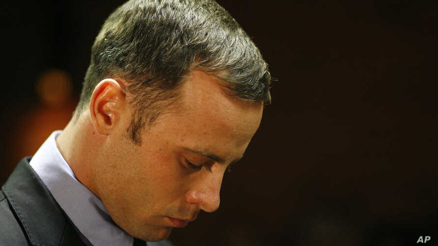 Olympic athlete Oscar Pistorius stands during his bail hearing at the magistrate court in Pretoria, South Africa, February 21, 2013
