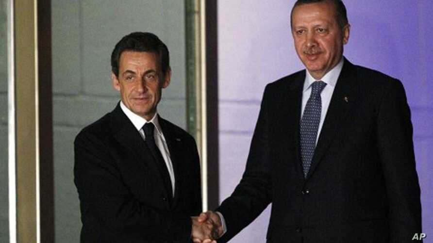 France's President Nicolas Sarkozy (L) shakes hands with Turkey's Prime Minister Tayyip Erdogan as he leaves a meeting in Ankara, February 25, 2011