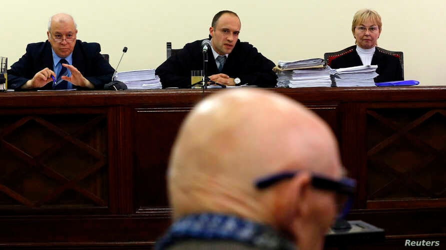 Former Communist Party leader Bela Biszku listens to judge Szabolcs Toth (top C) during his trial in Budapest, Hungary, March 18, 2014.