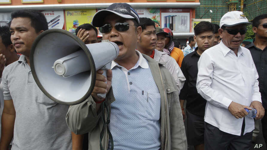 Pro-ruling party demonstrators stage a protest rally in front of National Assembly, in Phnom Penh, Cambodia, Monday, Oct. 26, 2015.