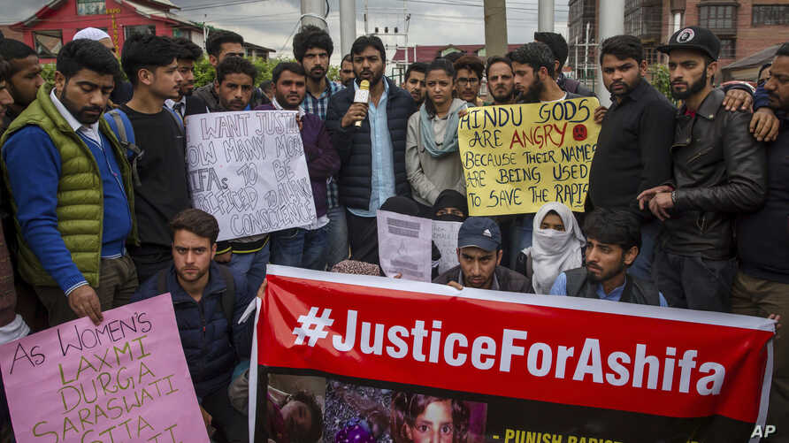 Students and others participate in a protest against the rape and murder of Asifa, an 8 year-old girl who was grazing her family's ponies on a chilly January day in the forests of the Himalayan foothills when she was kidnapped and her mutilated body