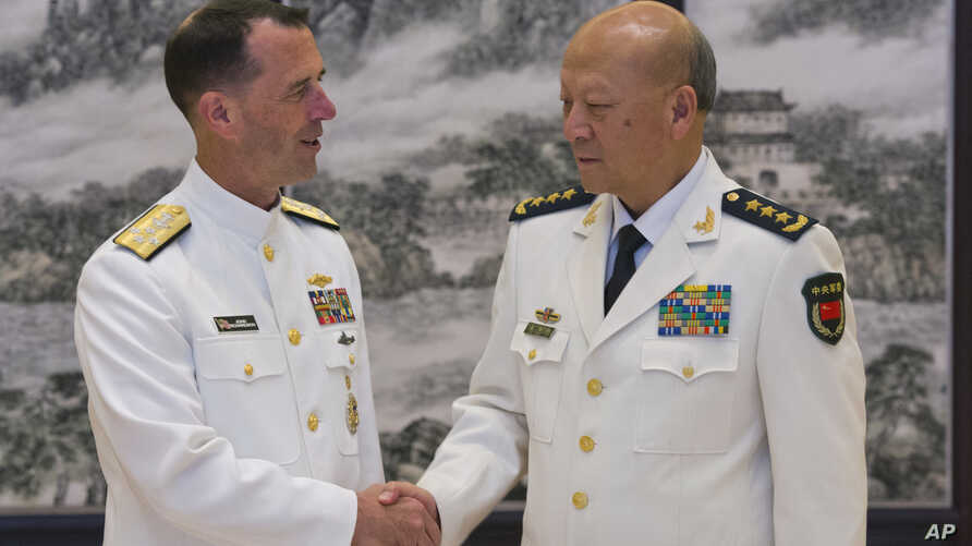 U.S. Chief of Naval Operations Adm. John Richardson (L) and Commander of the Chinese navy, Adm. Wu Shengli shake hands at Chinese Navy Headquarters in Beijing, July 18, 2016.