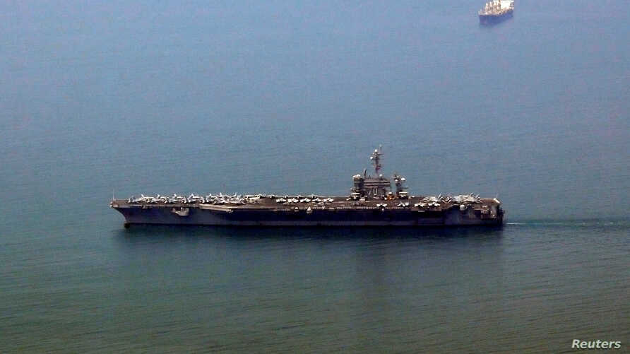The US aircraft carrier USS Carl Vinson arrives at a port in Danang, Vietnam March 5, 2018.