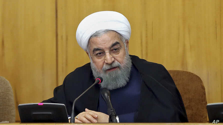 In this photo released by official website of the office of the Iranian presidency, President Hassan Rouhani speaks during a cabinet meeting in Tehran, Iran, July 19, 2017. The U.S. House of Representatives voted overwhelmingly July 25, 2017, in favo