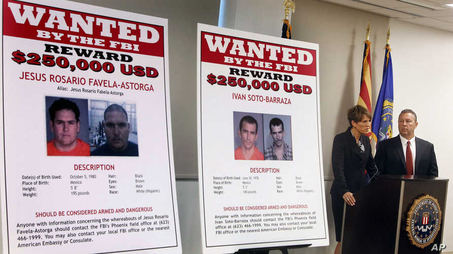 FILE - Laura E. Duffy, United States Attorney Southern District of California, and FBI Special Agent in Charge, James L. Turgal, Jr., right, announce the indictments on five suspects involved in the death of U.S. Border Patrol agent Brian Terry in Tu