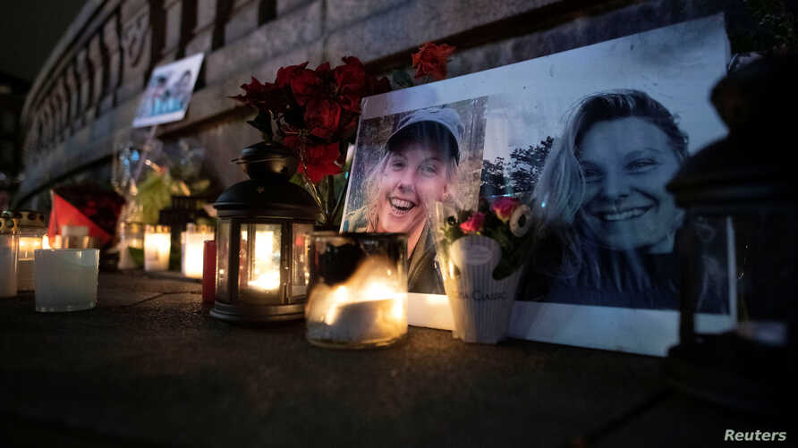 Flowers and candles in memory of Louisa Vesterager Jespersen and Maren Ueland, who were killed in Morocco during a trekking trip, are seen at the Town Hall Square in Copenhagen, Denmark, Dec. 28, 2018.