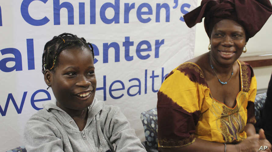 Janet Sylva and her mother, Philomena, smile during a press conference at Cohen Children's Medical Center in New Hyde Park, N.Y., March 9, 2017.