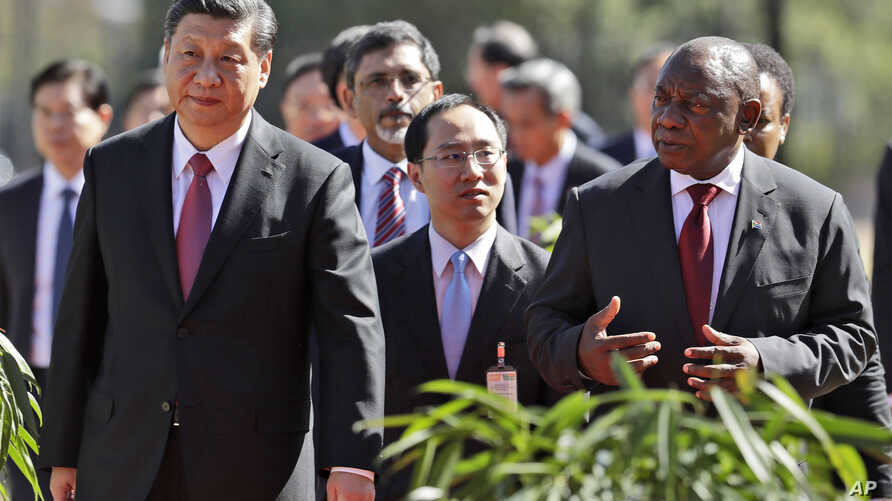 China's President Xi Jinping, left, walks with South African President Cyril Ramaphosa after a joint press conference at the government's Union Buildings in Pretoria, South Africa, July 24, 2018. Xi is in the country to attend a three-day BRICS Summi