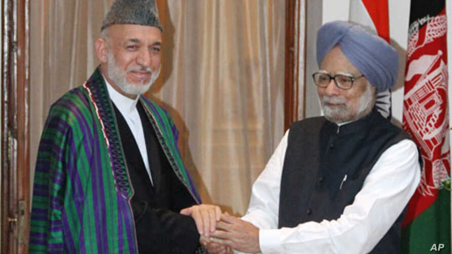 Afghan President Hamid Karzai with Indian Prime Minister Manmohan Singh, Oct. 4, 2011.