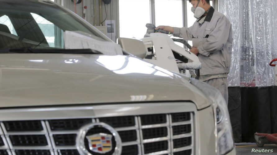 A staff member works at a service center for repairing Cadillac cars at its dealership in Beijing, China, March 14, 2016.