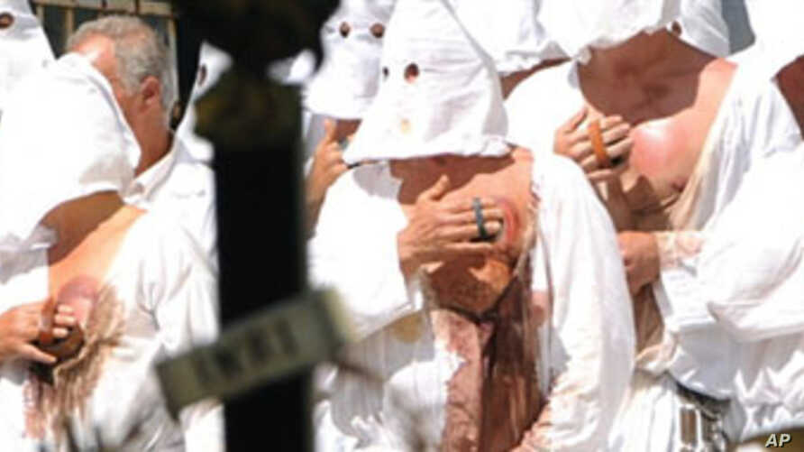 "Christian penitents known locally as ""Battenti"" beas themselves during a procession in honor of the Virgin Mary in Guardia Sanframondi,  near Benevento south of Italy, on August 22, 2010."