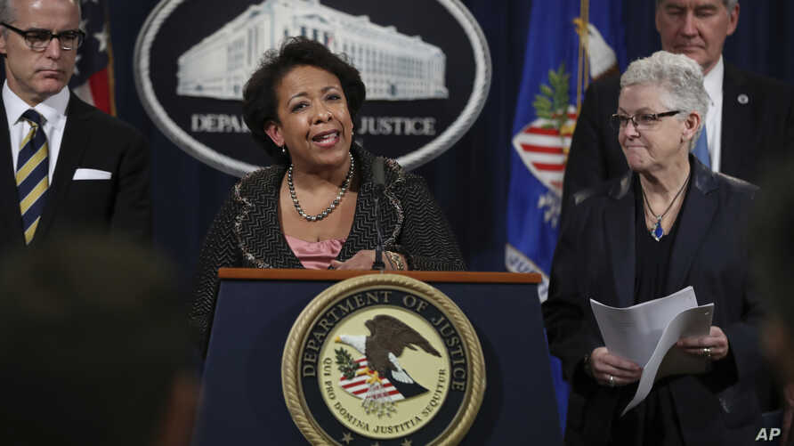 Attorney General Loretta Lynch, center, with Environmental Protection Agency (EPA) Administrator Gina McCarthy, Acting Deputy Secretary Russell Deyo for the Department of Homeland Security, and FBI Deputy Director Andrew McCabe, speak during a news c