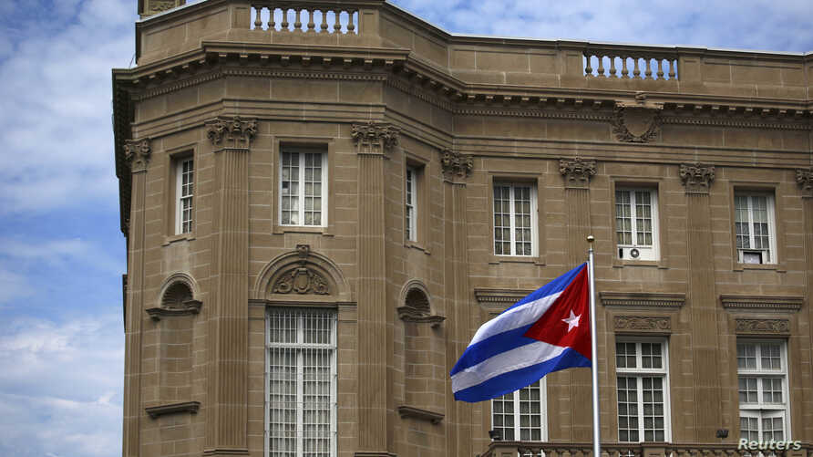 FILE - The Cuban national flag is seen raised over their embassy in Washington, July 20, 2015.