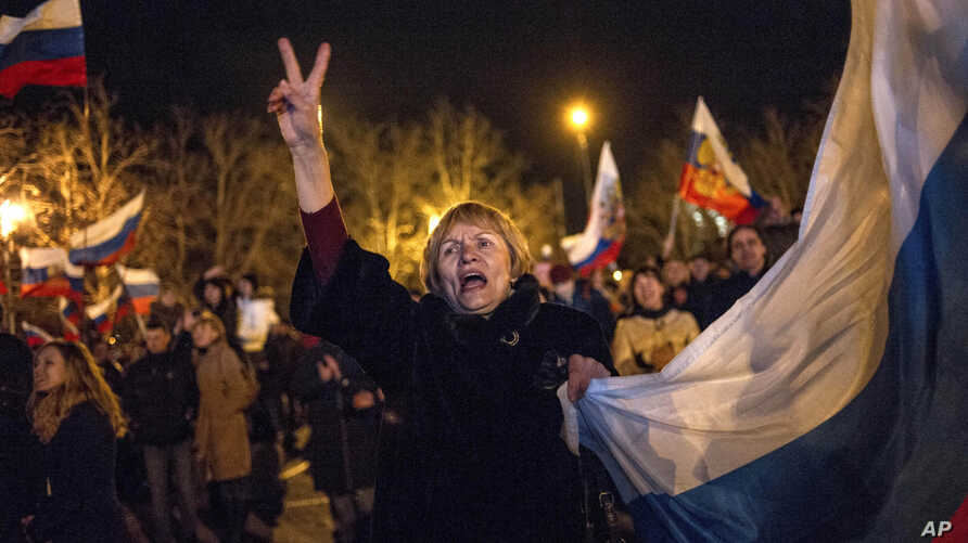 Pro-Russian people celebrate in the central square in Sevastopol, Ukraine, March 16, 2014.