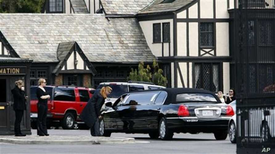 A stretch limousine arrives at Forest Lawn Cemetery for funeral services for Elizabeth Taylor in Glendale, Calif., March 24, 2011