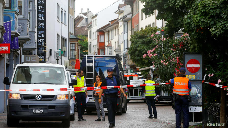 Swiss police officers stand at a crime scene in Schaffhausen, Switzerland, July 24, 2017.